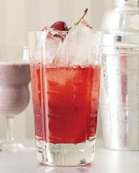 Colorado Cooler  1 ounce chilled club soda  3/4 ounce fresh lemon juice  3/4 ounce Simple Syrup  2 ounces malt whiskey, preferably Stranahan's Colorado Whiskey  Ice  2 dashes of celery bitters (optional)  4 cherries, preferably Rainier, pitted, plus 1 cherry for garnish
