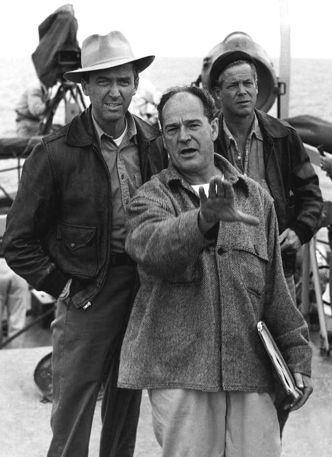 "Jimmy Stewart, director Anthony Mann and Dan Duryea on the set of ""Thunder Bay"", 1953."