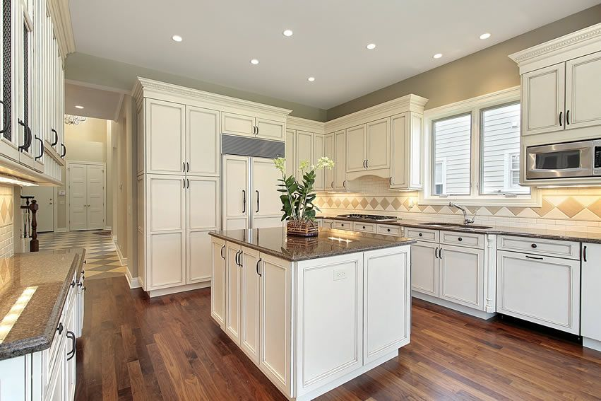 Traditional Kitchen With White Cabinets And Gray Granite Counters