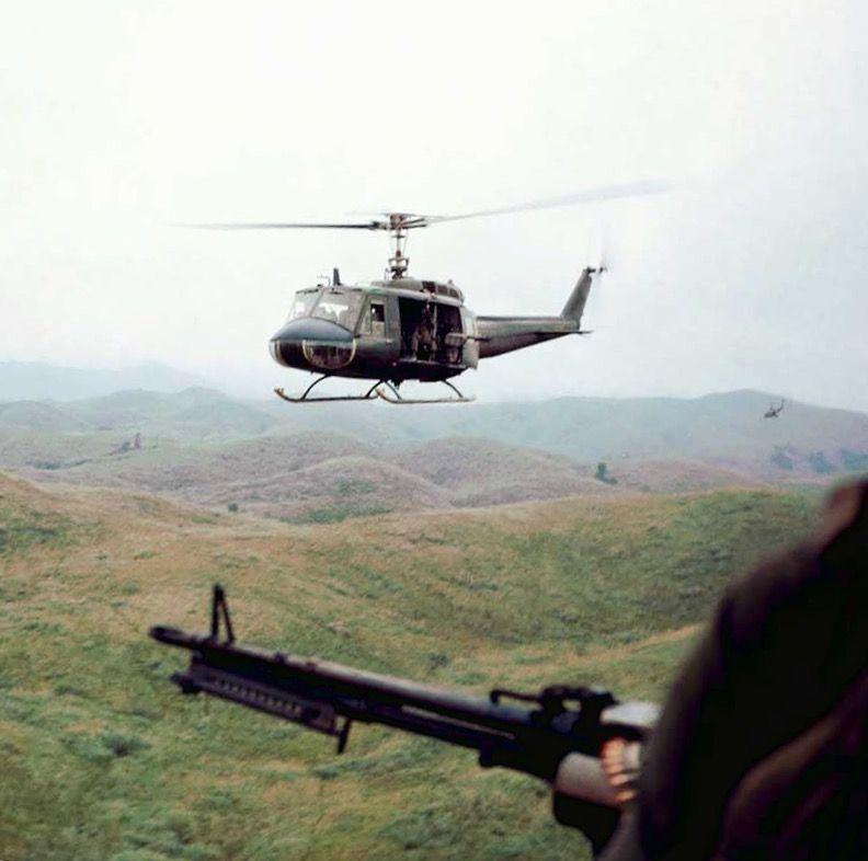 The view of a door gunner of a Huey helicopter - Vietnam War