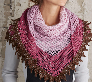 This delicate shawl, worked in a medley of cherry sundae colours, includes some truly delicious detail. The super-soft 100% alpaca yarn is just as scrummy to work with as it is to wear, and the addition of a shimmery silver yarn brings a suggestion of glamour. The alpaca and metallic yarns are held together and worked as one to achieve this glittery look.