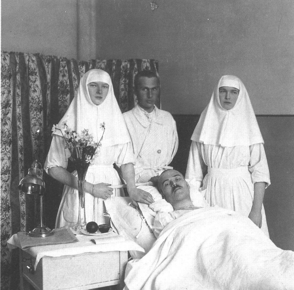 Grand Duchesses Tatiana and Olga in Red Cross nurses uniforms with wounded solders.
