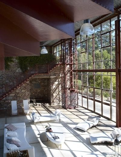 Why not have loungers in an area that is flooded with sunlight...love that glass wall and look at the staircase...and brick...sigh.