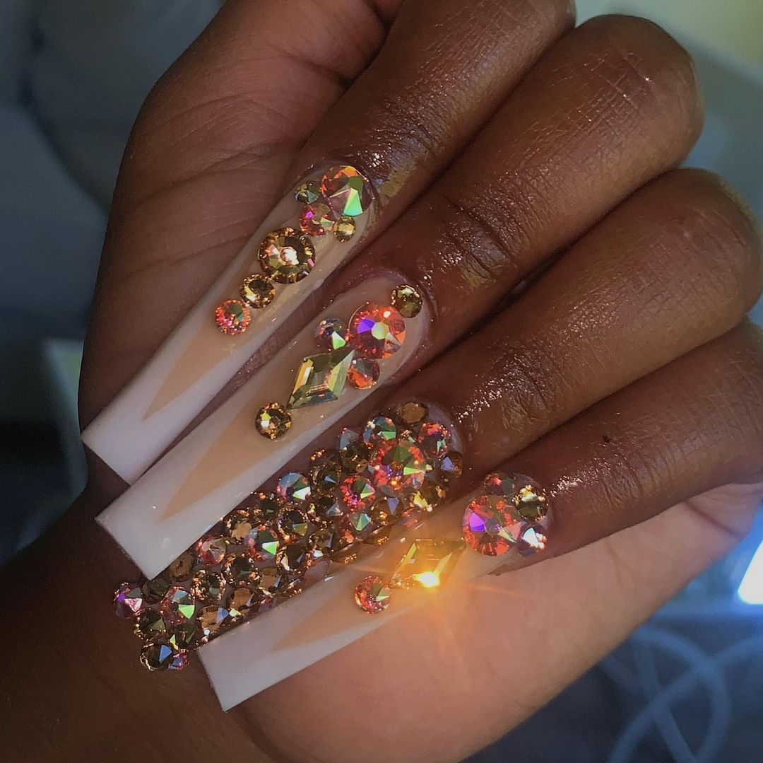 """nails by isela on Instagram: """"talk about blinged out 🤩 this was a graduation set!  • • •have you checked out my new body sculpting page yet? let's get you snatched for…"""""""