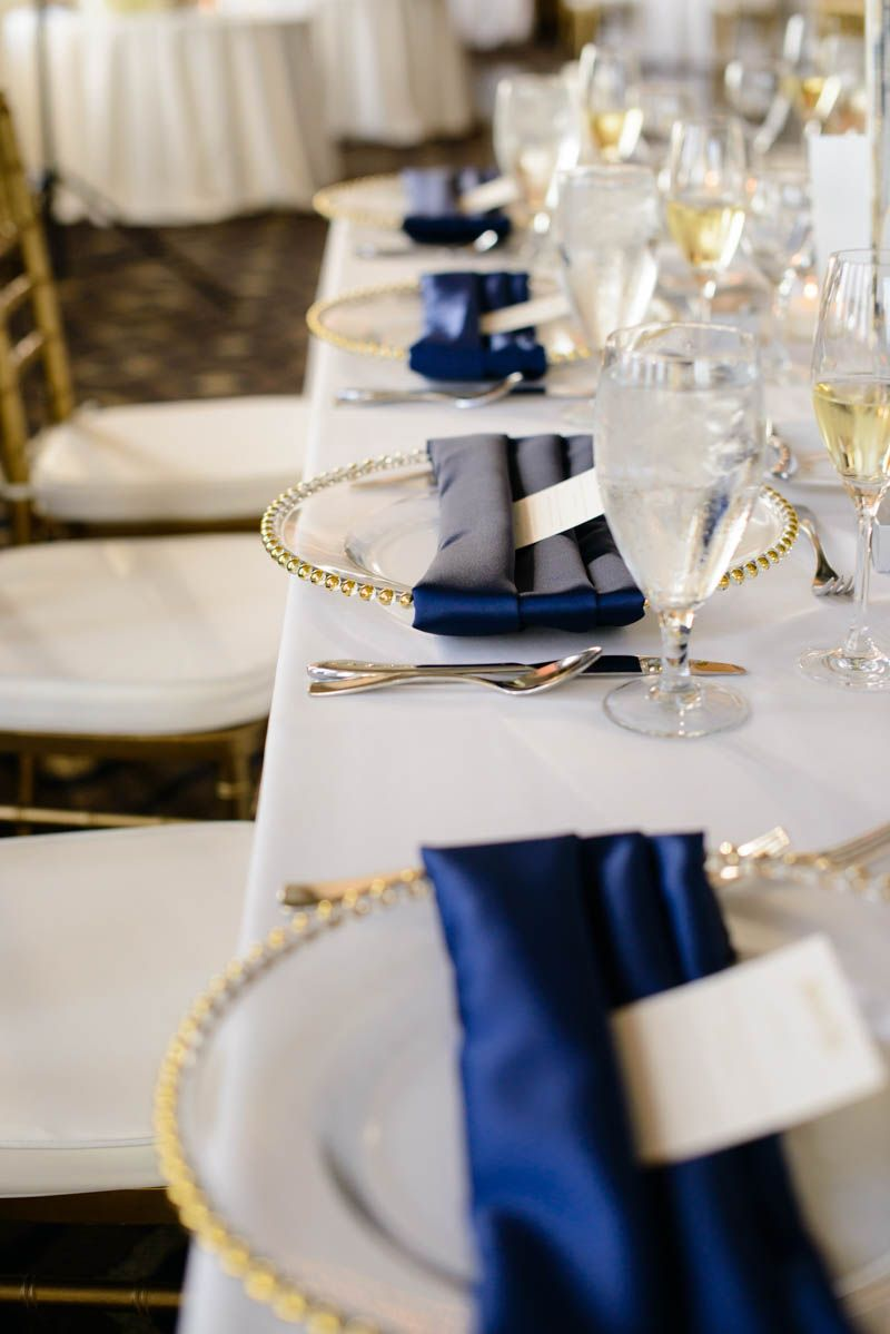 Gold Chargers by Orlando Wedding and Party Rentals - Navy and Gold ...