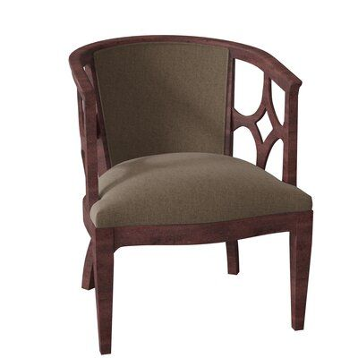 Fairfield Chair The small scale of this Quinn Armchair is defined by the rounded back shape with open carved exposed wood. The upholstered seat and back are softly padded. The detail of the outside end suggests this chair can be used as accent seating or with a desk. Body Fabric: 9953 Blush, Leg Color: Montego Bay