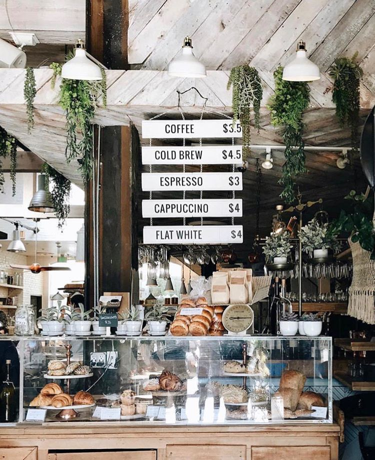 Cute Coffee Shop With Greenery Rustic Quaint Vibe The Butcher S Daughter Cute Coffee Shop Cozy Coffee Shop Coffee Shop Decor