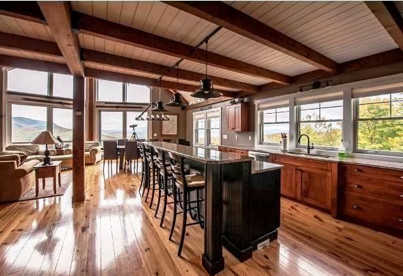 An open floor plan in a post and beam mountain style ...