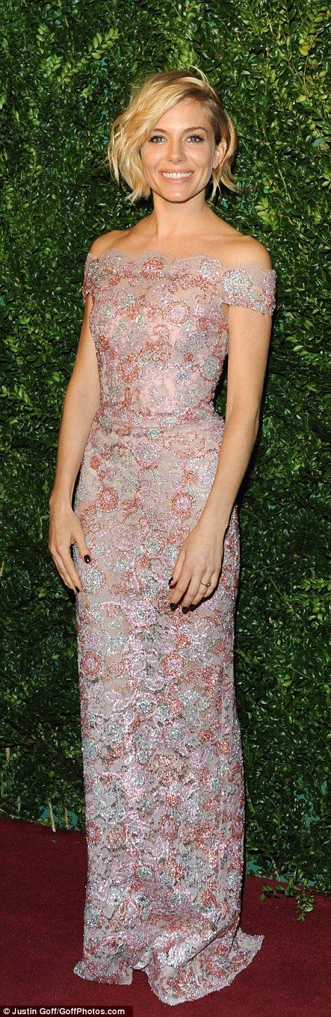Metallic marvel: Actress Sienna Miller looked incredible in a floor-length lace gown which...