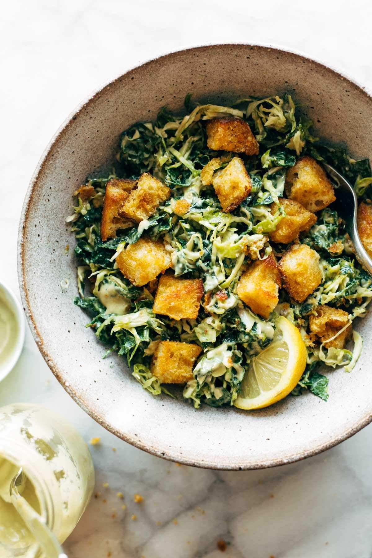 Brussels Kale Caesar With Cheezy Garlic Croutons Pinch Of Yum Recipe Clean Eating Recipes Garlic Crouton Kale Recipes