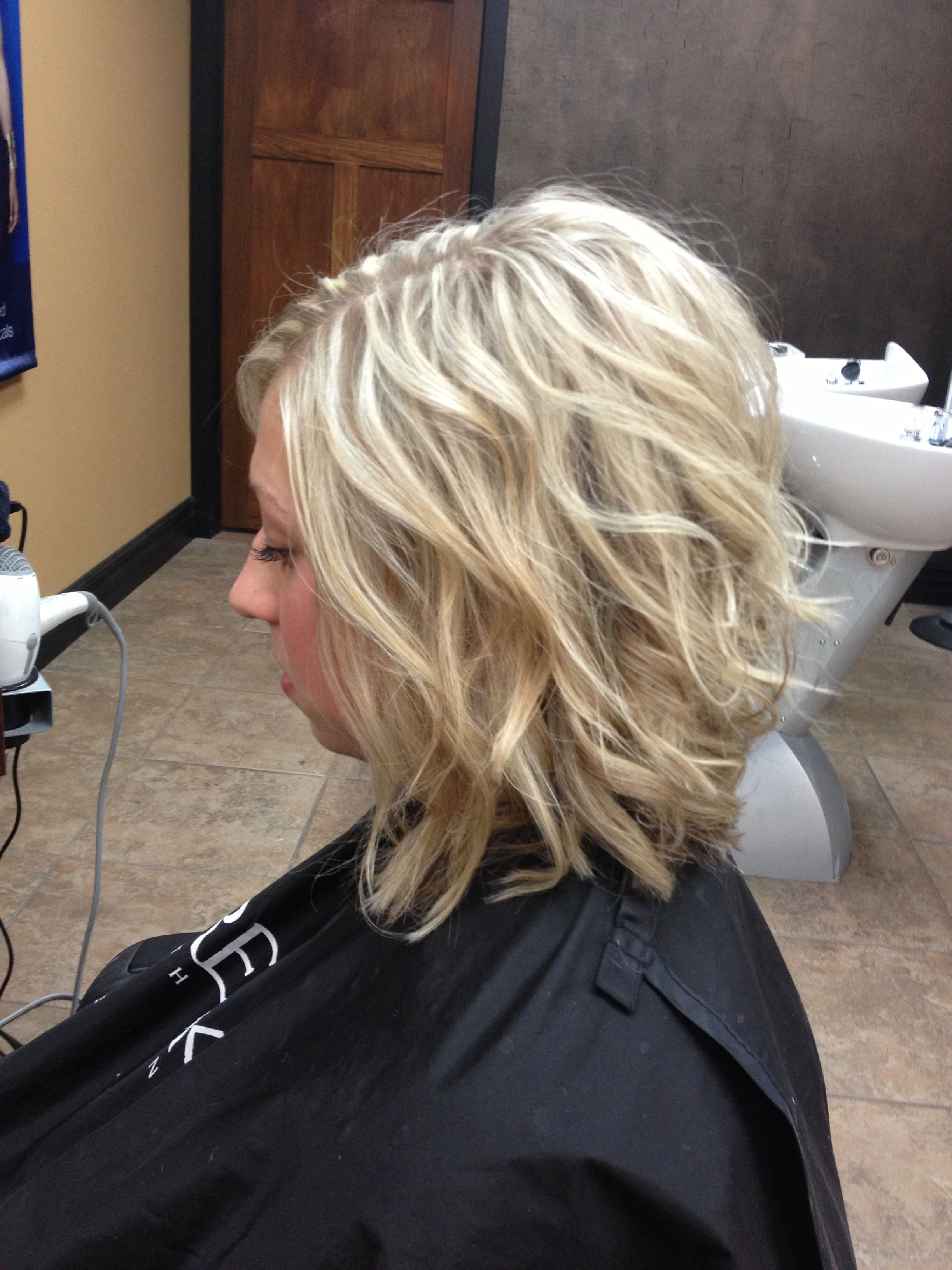 Slightly Inverted Bob, With Long Layers. Color: Heavy Full