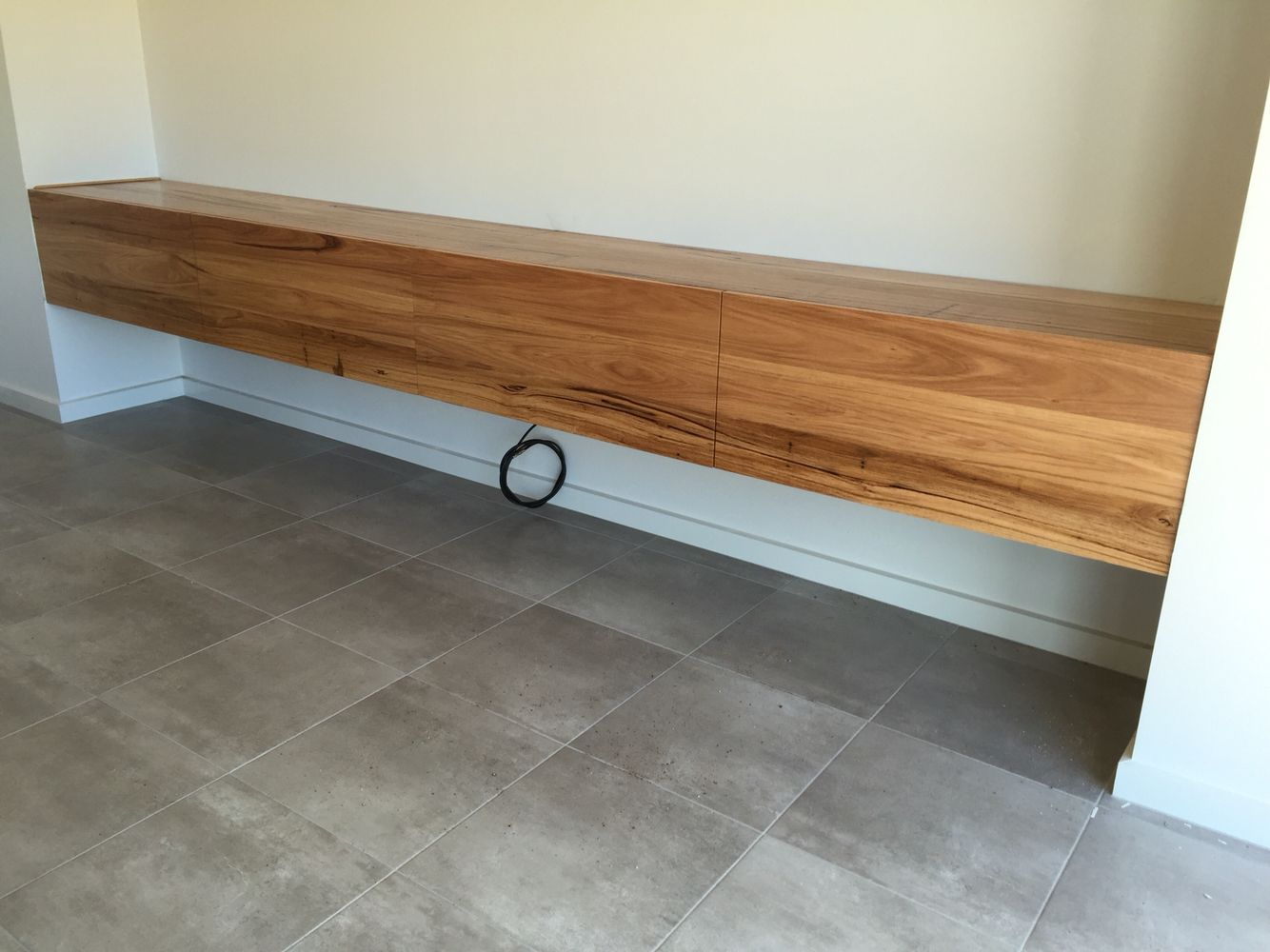 Wormy chestnut timber floating TV unit | Timber TV units ...