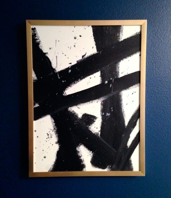 Glitter and goat cheese diy abstract black and white art in a spray painted gold frame