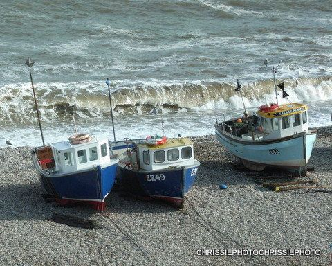 Fishing Boats on  Beer beach South Devon a by Chrissiephoto