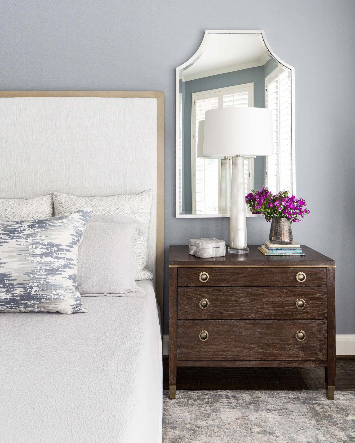 Soothing master bedroom in blue gray color palette with mirror and glass lamp Carla Aston Designer  Colleen Scott Photographer