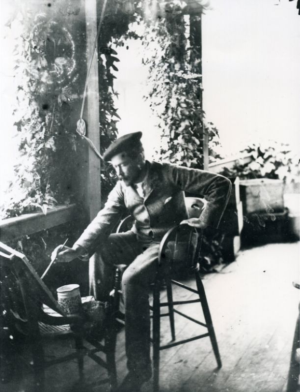 Attributed to Karl Thaxter (1852–1912), Childe Hassam painting on the porch of Celia Thaxter's cottage, 1880–1910, archival photograph, Portsmouth Athenaeum, Isles of Shoals Photograph Collection.