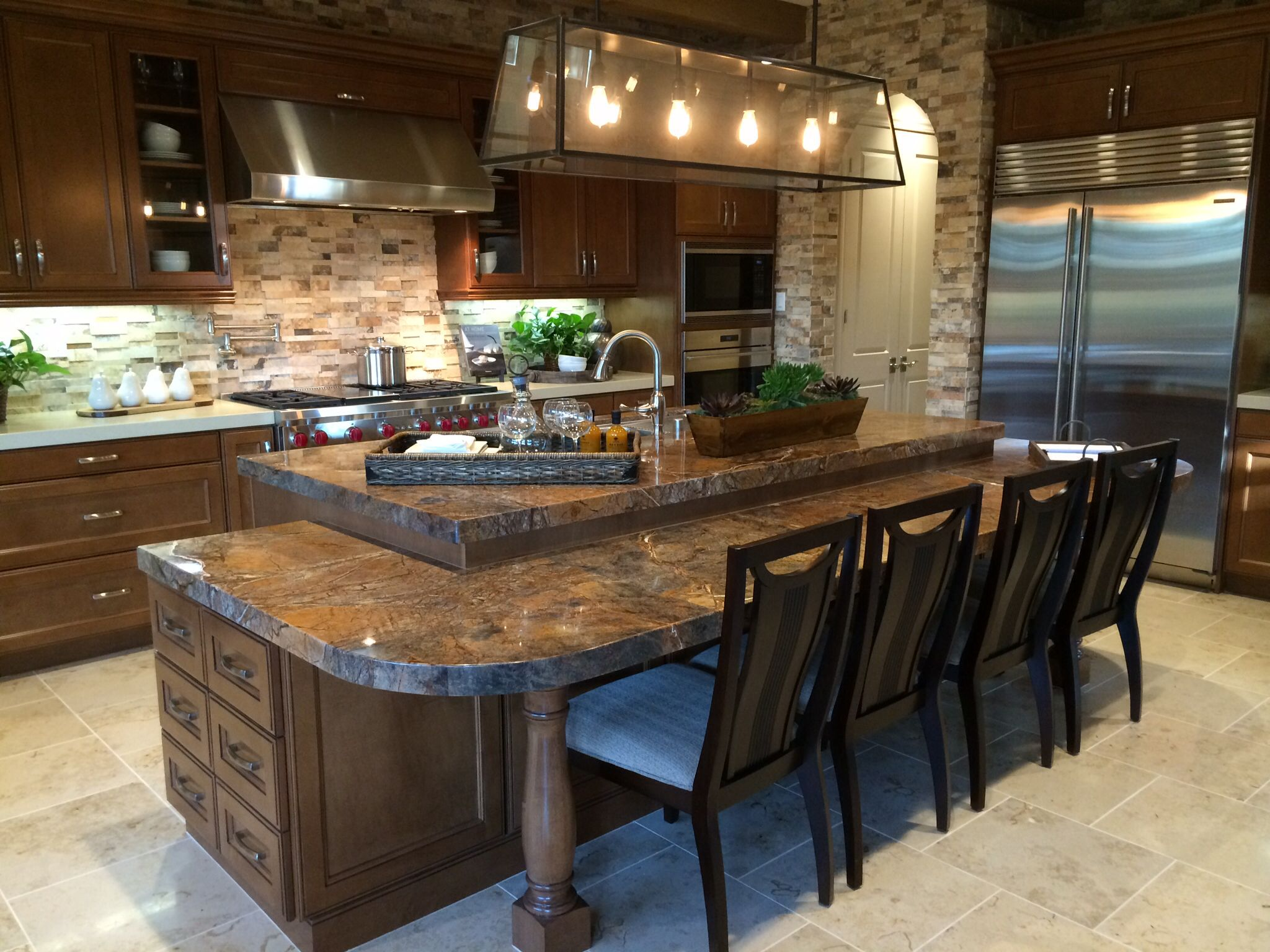 I like this kitchen island size and layout that can seat 4 6