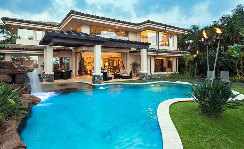 contemporary house with custom rock swimming pool and waterfall