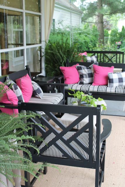 Black patio furniture with black and white buffalo plaid and pink pillows. - Black Patio Furniture With Black And White Buffalo Plaid And Pink