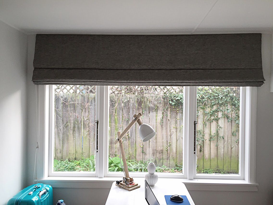 Bed with window behind it  roman blinds are the perfect solution to a small space small