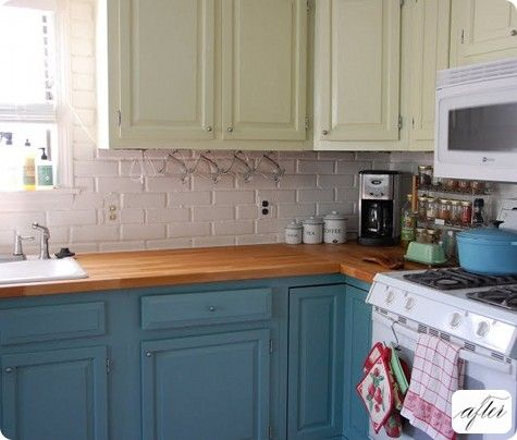 one example of kitchen cabinets painted in two colors that i like