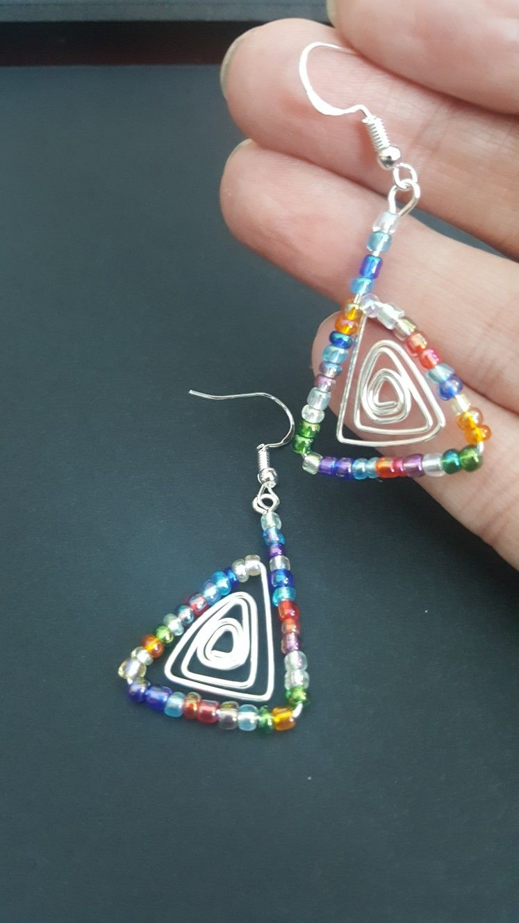 170f45201ab2 Silver triangle with seed beads found on SoulProjects on Facebook. Seed  Bead Earrings