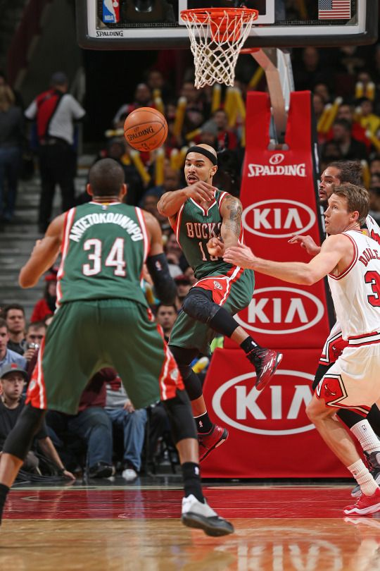 Jerryd Bayless #19 of the Milwaukee Bucks passes the ball against the Chicago Bulls during the game on February 23, 2015 at the United Center in Chicago, Illinois. (Photo by Gary Dineen/NBAE via Getty Images)