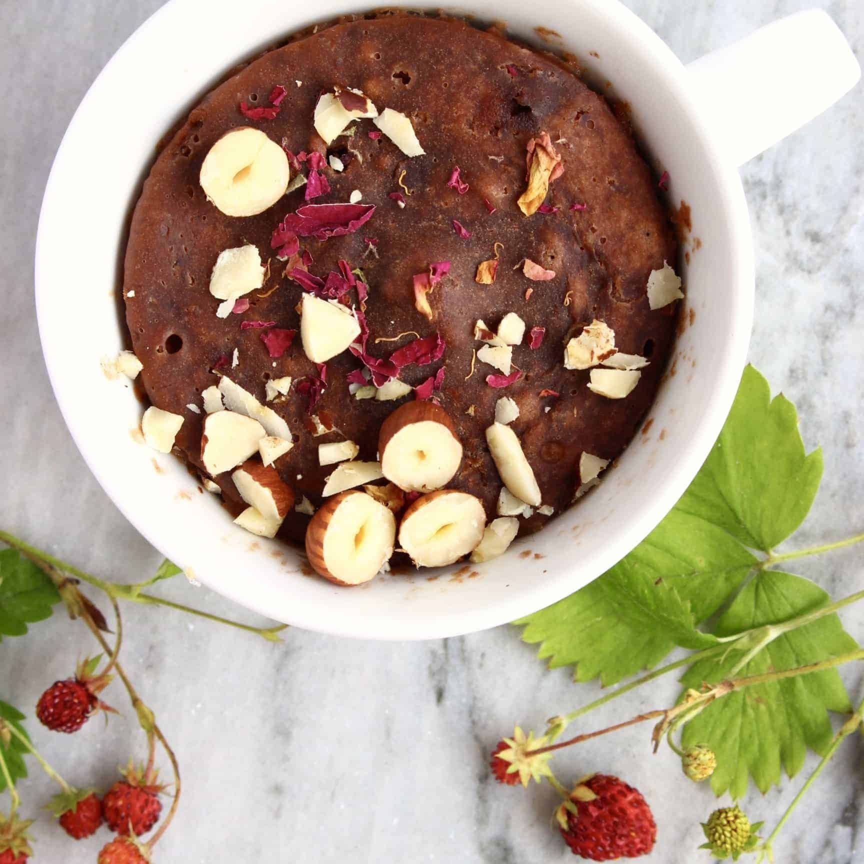 This healthy Vegan Chocolate Microwave Mug Cake requires just 5 ingredients and takes only 5 minutes to make! Refined sugar free and gluten-free optional.