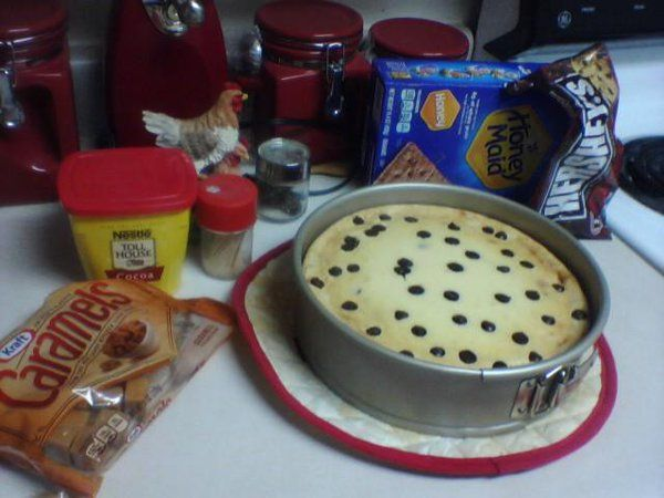 Caramel Chocolate Chip Cheesecake - Finished by topping w/melted caramels, choc chips and chopped nuts(the trick to having those choc chips stay put throughout, is to dust them in flour prior to mixing in/baking)