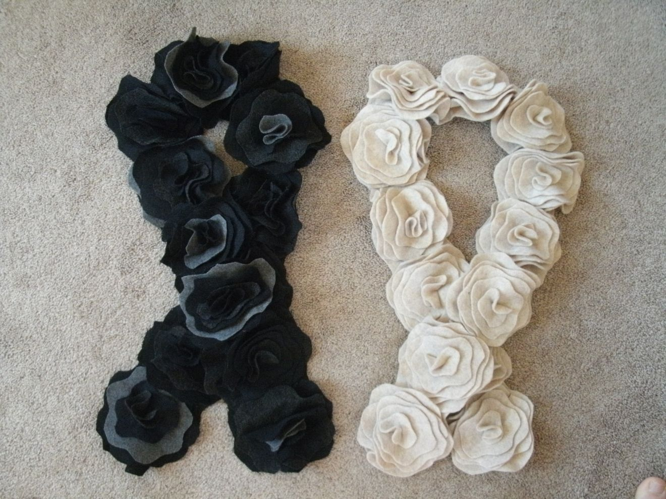 Two of my rosette scarves from the tutorial at watchmedaddy.blogspot.com.  The gray/black one made from felted wool skirts and the light one from felt.  They are very easy and fun to make!