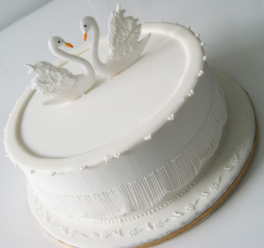 Cake covered in Royal icing, Royal icing swan toppers ...