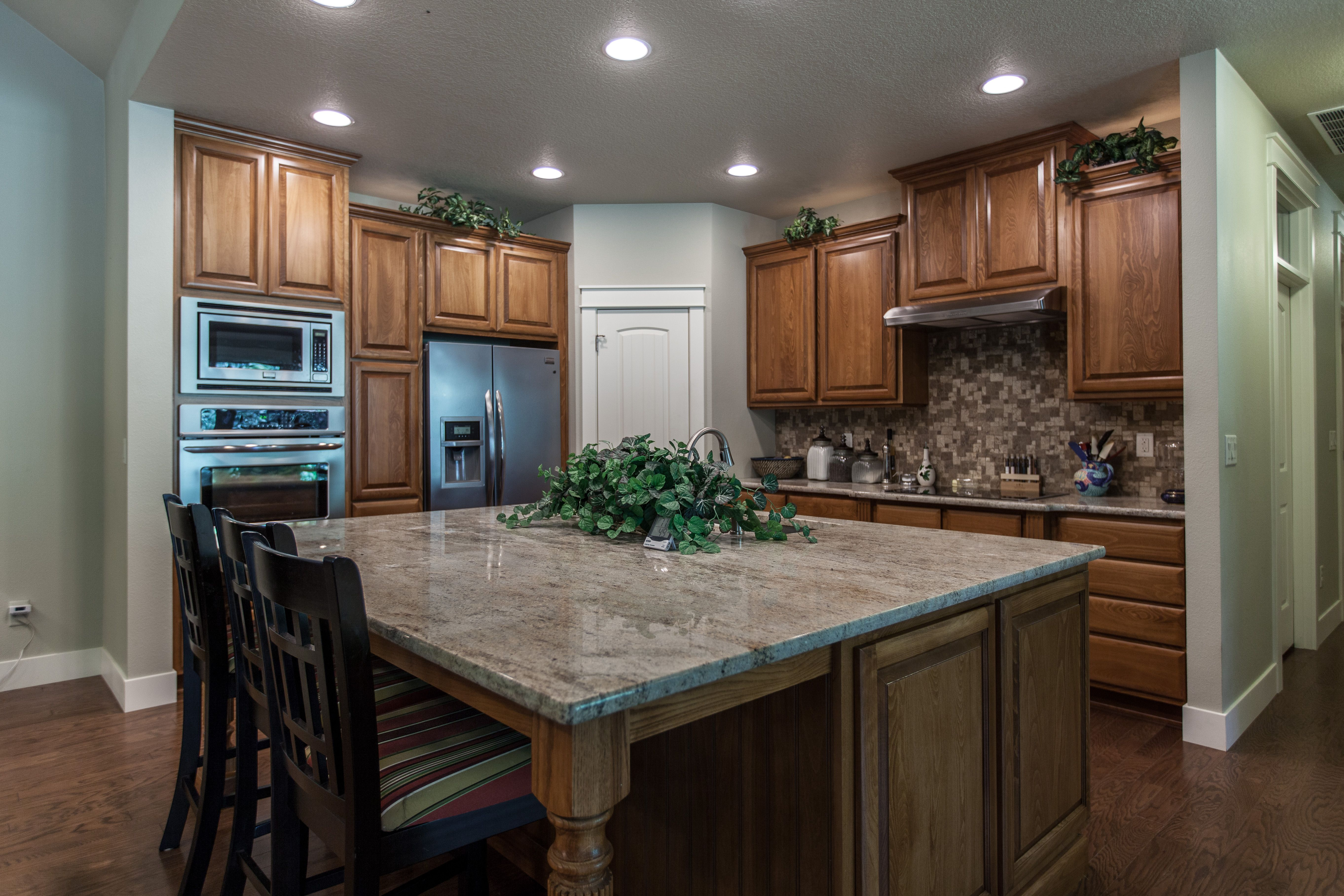 Kitchen with large island and stainless steel appliances