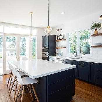 Navy blue kitchen cabinets with brushed brass pulls and for Navy blue kitchen ideas