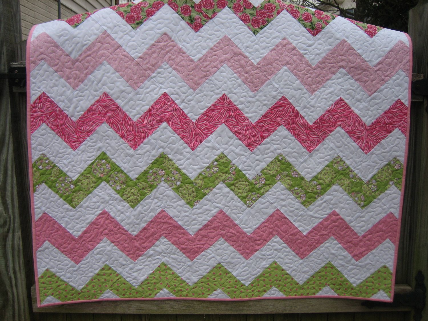 Chevron or Zig Zag Quilt in Pinks and Greens. $80.00, via Etsy.
