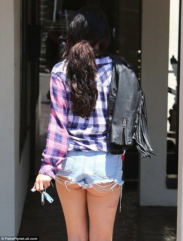 Selena Gomez exposes her derriere in VERY short cut-offs in LA
