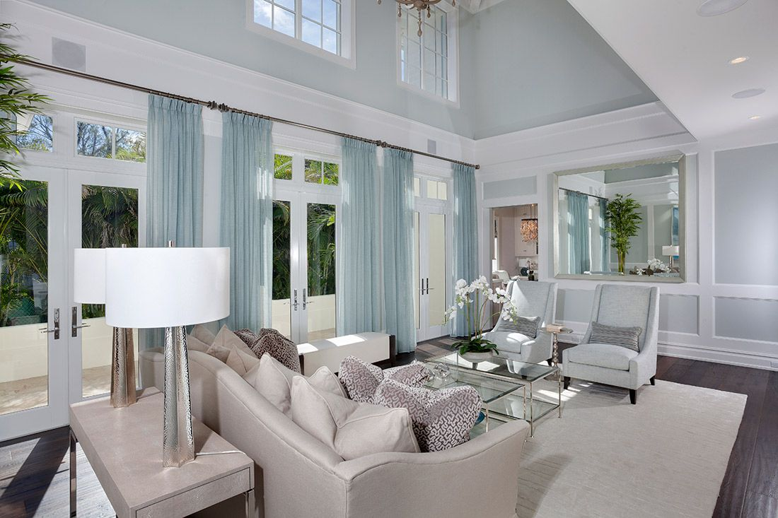 Living Spaces | Casatopia | Surya WVE-1003 Rug | Benjamin Moore OC-20 Paint | Blue Bernhardt Zowie Chairs | Custom Drapery | Bernhardt Salon Mirror | @bernhardtinc