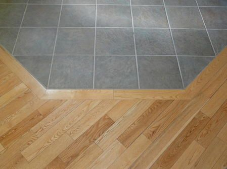 ceramic tile to hardwood transition. Would look nice with brown tile grout - Ceramic Tile To Hardwood Transition. Would Look Nice With Brown