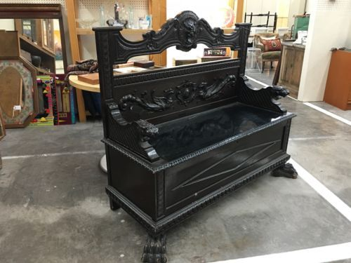 """Cool Black Carved Wood Bench   52"""" Wide x 23"""" Deep x 48"""" High   $495  Lula B's in the OC! 1982 Ft. Worth Ave. Dallas, TX 75208  Open Daily Mon. -- Sat. 11 to 7 Sun. 12 to 7  Like us on F"""