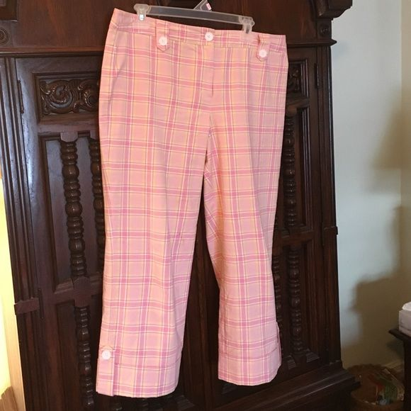 Ann Taylor Loft size 14 Plaid Pink Capri Pants Perfect condition Ann Taylor Loft Capri Pants in a super cute yellow, pink and white plaid print. Cute button detailing at waist and around the hem. These were purchased new and I wore them once last summer and now they don't fit me. Ann Taylor Loft Pants Capris