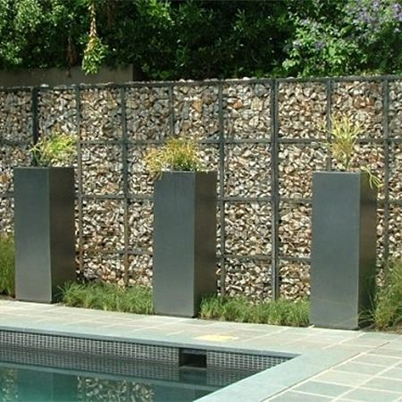 Gabions Are Another Walling Option That Is Growing In Popularity Again Not A Cheap Option But Definitely One That Adds Curb Appeal An Landscaping Retaining Walls Gabion Wall Gabion Baskets