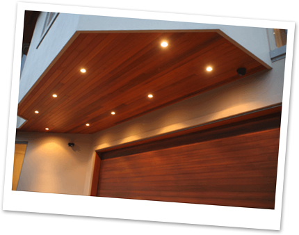 I love the effect of stained wood soffits with can lights Very