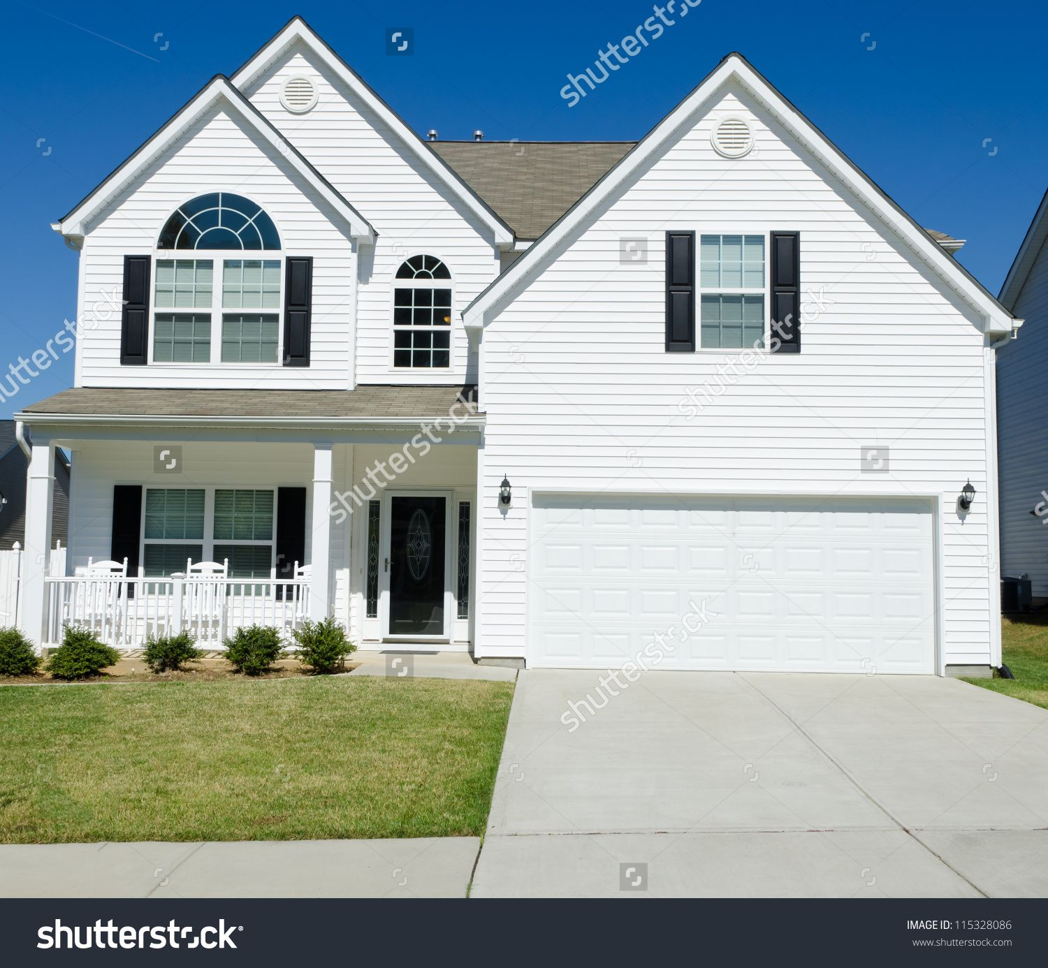 Residential House With White Vinyl Siding Exterior