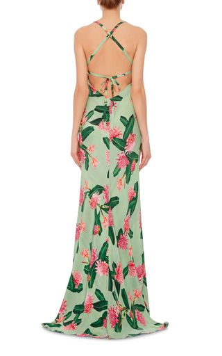 This **Isolda** dress features a V neck and camisole straps and is crafted in floral printed silk crepe.