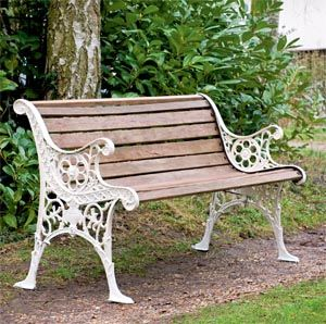 Restored Edwardian garden bench with wooden slats and cast iron