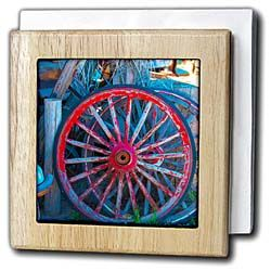 Old Wheels from a wagon set aside in red and blue Tile Napkin Holder