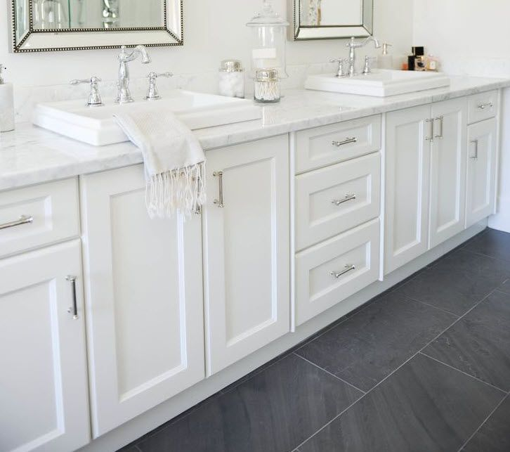 Master Bath Black Floor Tile With White Vanity And Silver