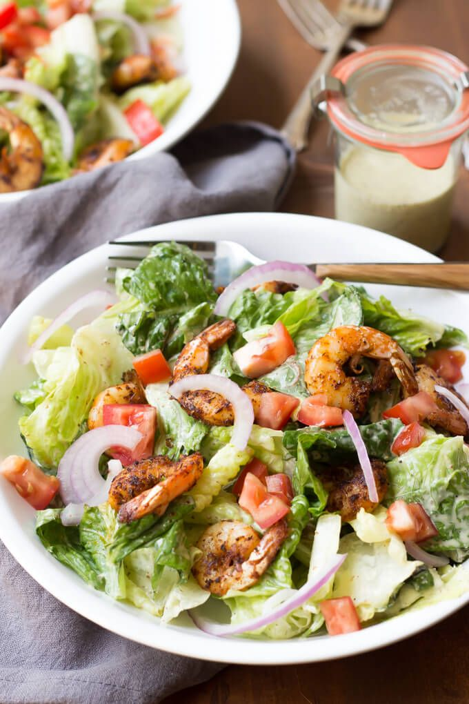 This Paleo Caesar Salad uses a classic dressing and is topped with easy Cajun Shrimp for a dinner that's ready in less than 30!
