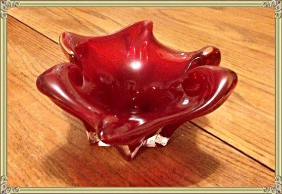 This is a rare vintage collectible 1950s Murano Italian Art Glass cigar ash tray in dark ruby red. This special piece of glass boasts receding color with it's white base bottom and flared design.
