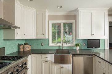 Cream Kitchen Cabinets With Black Countertops And