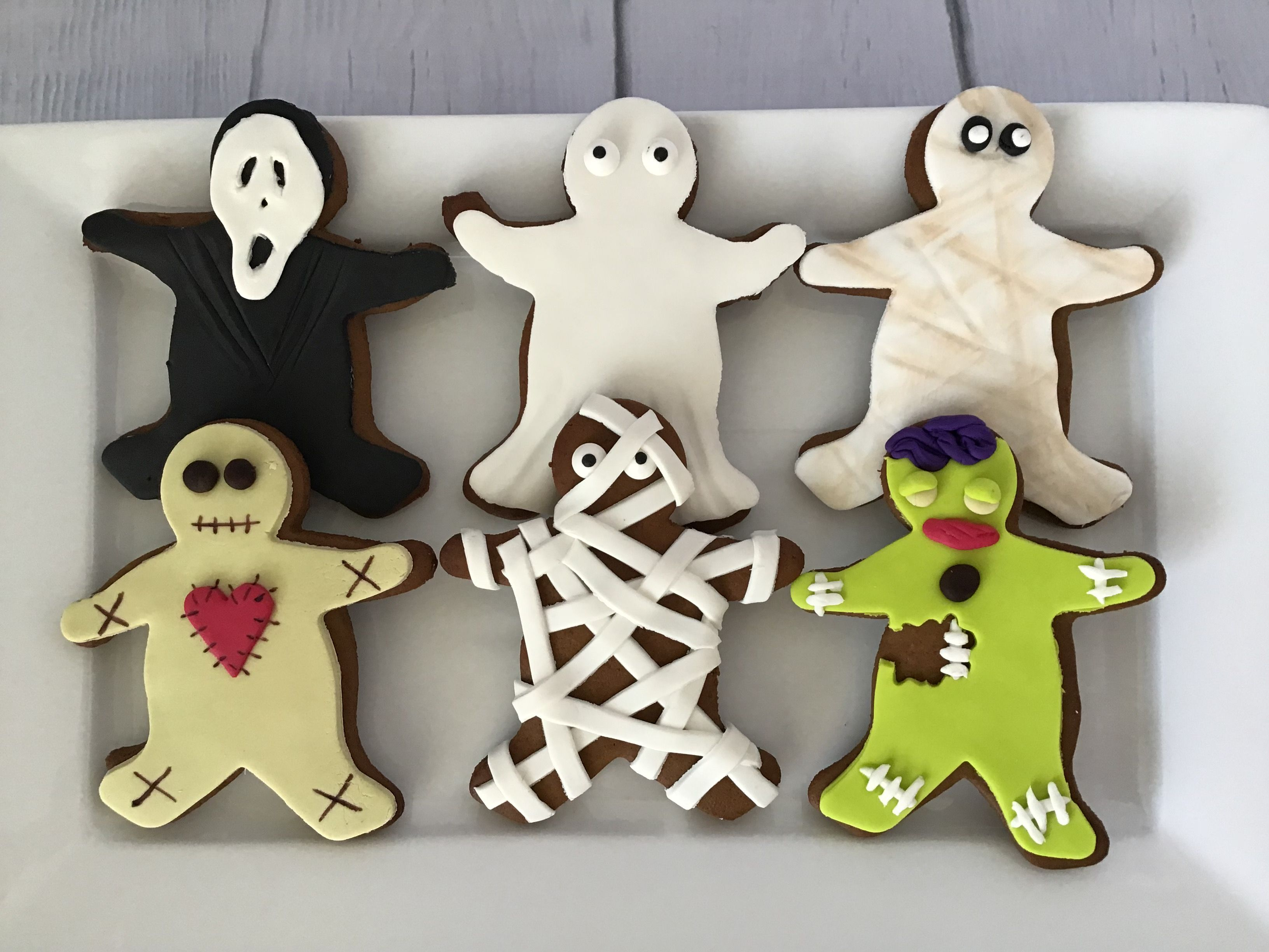 Halloween gingerbread men with images holiday treats